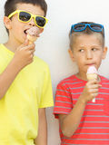 Young kids boys eating ice cream. Stock Photos