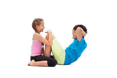 Young kids doing abs exercises together - helping each other Stock Image