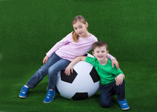 Young kids with huge soccer ball Royalty Free Stock Images