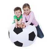 Young kids with huge soccer ball Stock Photo