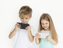 Young Kids Playing Mobile Phone Stock Photography