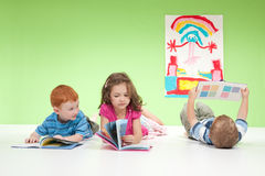 Young kids reading books Stock Photo