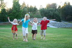 Young kids running outside Stock Photo