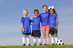 Young Kids on a Soccer Team. A portrait of four young kids on a youth recreation league soccer team Stock Photography