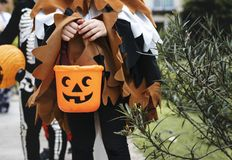 Free Young Kids Trick Or Treating During Halloween Royalty Free Stock Photos - 125060288