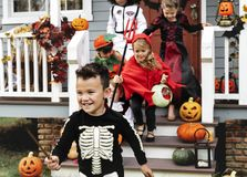 Young kids trick or treating during Halloween royalty free stock photos