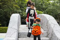 Young kids trick or treating during Halloween stock image