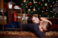 Young kids waiting for Santa Stock Images