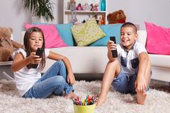 Young Kids Watching TV Royalty Free Stock Image