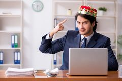 The young king businessman working in the office. Young king businessman working in the office stock photo