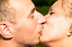Young kissing couple Royalty Free Stock Photography