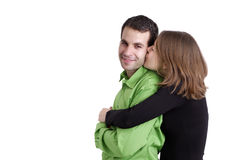 Young kissing couple against whitte background Stock Photos
