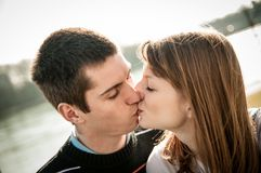 Young kissing couple in love Royalty Free Stock Photography