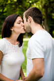 Young kissing couple in love Royalty Free Stock Image