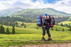 Young kissing couple in the mountain stock photography