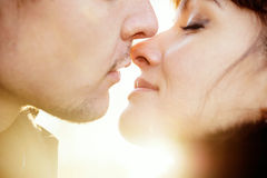 Young kissing couple at sunshine Stock Photography