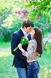 Young kissing happy couple in love Royalty Free Stock Photography
