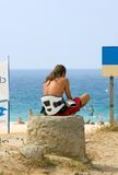 Young Kite surfer dude waiting for waves and wind royalty free stock images