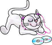 Young kitten listening to music on headphones. Young little cat listening to music on headphones Royalty Free Stock Images