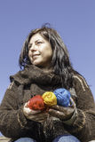 Young knitter with coloured yarn of wool. Young knitter with coloured yarns of wool in her hands Royalty Free Stock Photo
