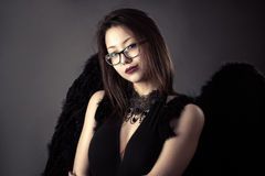 Young Korean girl with black wings Stock Photos