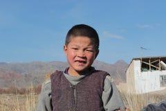 Young kyrgyz boy looking into the camera Stock Photos