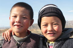 Young kyrgyz brothers looking into the camera, kyrgyzstan, portrait of two friends Stock Photos