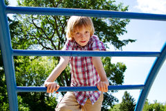 Young lad climbing on playground Royalty Free Stock Photography