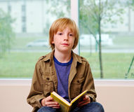 Young lad reading book Royalty Free Stock Photography