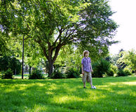 Young lad about to kick soccer ball. Young lad at park ready to kick soccer ball Royalty Free Stock Photos