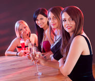 Young ladies at a bar counter Royalty Free Stock Image