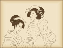 Young ladies drinking tea Royalty Free Stock Images