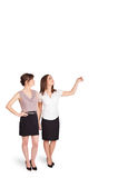 Young ladies gesturing with copy space Royalty Free Stock Photos