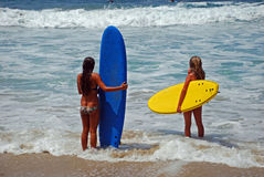 Young ladies getting ready to surf in Laguna Beach, California. Stock Image