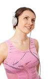 Young ladies in headphones listening to music Royalty Free Stock Images
