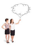 Young ladies holding cloud balloon drawing Royalty Free Stock Photography