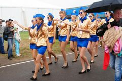 Young ladies march at MAKS-2013. Young ladies dressed in golden jackets march at International Aerospace Salon MAKS-2013. Taken on August 30, 2013 in Zhukovsky Stock Image