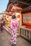 Young Ladies praying for love at Kiyomizu-dera in Kyoto, Japan. Kyoto, Japan -November 2, 2018: Young girls in traditional Japanese costume praying in front of royalty free stock photos