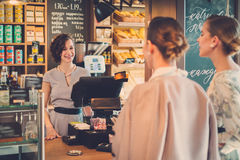 Young ladies shopping in a bakery.  stock photography
