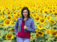 Young Lady. Beautiful lady posing in a field on sunny day Stock Image