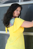 Young Lady. In yellow shirt with long hair and braces Royalty Free Stock Photography