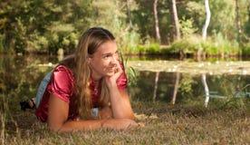 Young lady. Posing near a lake Royalty Free Stock Photos