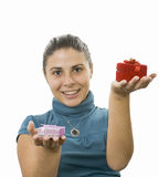 Young lady. Comparing two gifts Stock Photography