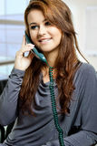 A young lady answering phone call Stock Photos
