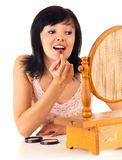 Young lady applying lipstick Stock Image