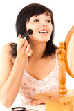 Young lady applying make up Stock Photography