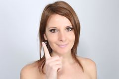 Young lady applying moisturizer on her face Royalty Free Stock Photo