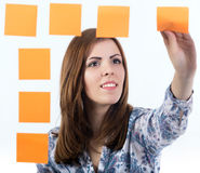Young lady attaches sticker to the board Stock Photography