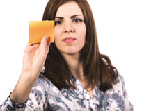 Young lady attaches sticker to the board Stock Photo