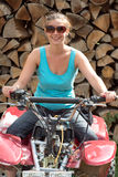 Young lady on ATV Royalty Free Stock Images